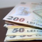 Avertisment FMI pentru România: Leul ar putea scădea cu 15-20%
