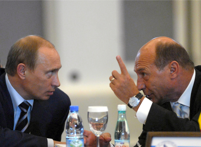 Romanian President Basescu gestures as he talks to Russia's President Putin during the 15th Summit of Black Sea Economic Cooperation Organisation in Istanbul