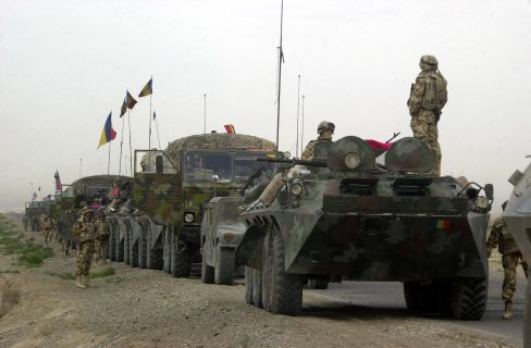 A Romanian Army B33 (8X8) Armored Personnel Carrier (APC) leads a convoy of multi-national vehicles from Kandahar Airfield to Kabul, the capital of Afghanistan. The purpose of the convoy is to gather information and to help with a road reconstruction project in Afghanistan during Operation ENDURING FREEDOM.